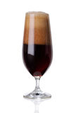 Dark beer with foam on white Stock Photo