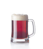 Dark beer. Glass with froth isolated on a white background Royalty Free Stock Photo