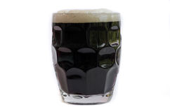 Dark beer. Glass of dark beer on white royalty free stock photos
