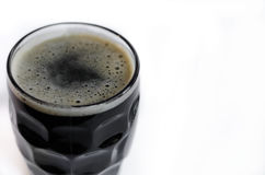 Dark beer. Glass of dark beer on white stock photography