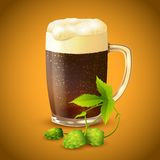 Dark beer and hop background Stock Images