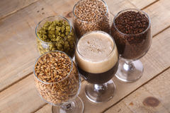 Dark beer and ingredients Stock Photo