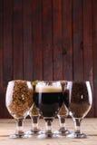 Dark beer and ingredients Stock Photos