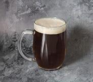 Dark beer in jar Royalty Free Stock Photos