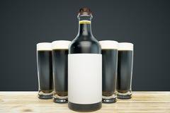 Dark beer mockup. Close up of dark beer bottle with blank label and full glasses on black background. Ad concept. Mock up, 3D Rendering Stock Images