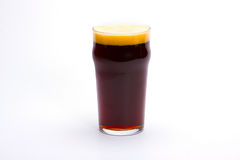 Dark beer. In mug; Objects on white background royalty free stock image
