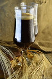 Dark beer in pints Stock Photography