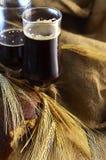 Dark beer in pints Royalty Free Stock Photo