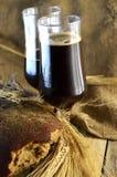 Dark beer in pints Royalty Free Stock Photos