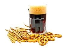 Dark beer and pretzels closeup. Dark beer and pretzels on white background Stock Image