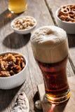 Dark beer with snacks Stock Image