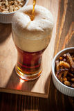 Dark beer with snacks Royalty Free Stock Images