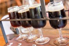 Dark beer tasting Stock Images