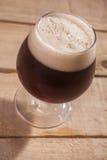 Dark beer on wood Stock Photos