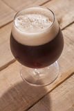 Dark beer on wood Royalty Free Stock Image