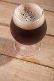 Dark beer on wood Stock Image