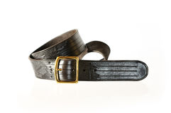 Dark belt with buckle isolated on white. Royalty Free Stock Photo