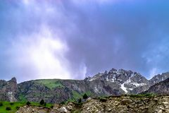 Dark big rocky Mountains covered with snow in Gilgit Pakistan royalty free stock image