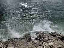 Dark billow on stone beach. Dark sea wave on stone beach stock photography