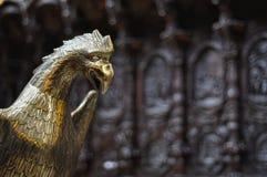 Dark bird statue with a dark wooden background royalty free stock photo