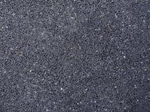 Dark black asphalt road surface stock image