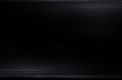 Dark and black carbon fiber background texture Stock Images