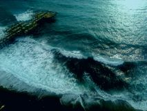 Dark sea, big waves in autumn stock photos