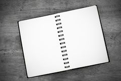 Dark black and white notebook on wooden table background. Note book on black and white background. Texture stock photos