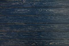 Dark black wood texture background viewed from above. The wooden planks are stacked horizontally and have a worn look stock photos