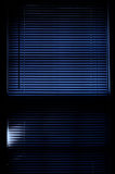 Dark blinds. Deep rich blue image of mini blinds covering window Stock Photo