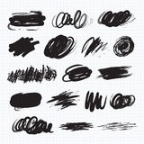 Dark blots. Scribble stains. Vector set of dark blots on the white background. Scribble stains. Charcoal chalk texture. On a sheet of exercise book. Vector Royalty Free Stock Image