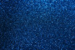 Dark blue sparkler background royalty free stock photography