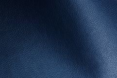 Dark Blue Artificial Leather Texture with Shadows Royalty Free Stock Photography