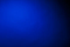 Dark blue background. In the photographic studio stock photo
