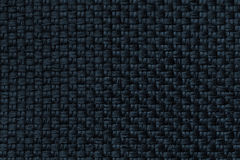 Dark blue background with checkered pattern, closeup. Structure of the fabric macro. Royalty Free Stock Image