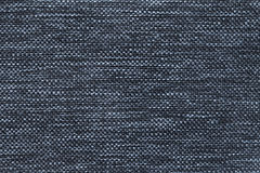 Dark blue background of dense woven bagging fabric, closeup. Structure of the textile macro. Stock Images