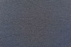 Dark blue background of fabric grained texture Royalty Free Stock Images