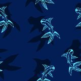 The dark-blue background with light fish silhouettes and their dark shadows. Vector seamless image Royalty Free Stock Image