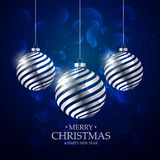 Dark blue background with silver christmas balls and bokeh effec Stock Photography