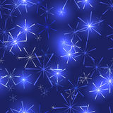 Dark blue background with stars or snowflakes Royalty Free Stock Images