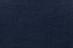 Dark blue background from a textile material. Fabric with natural texture. Backdrop. Dark blue background from a textile material. Fabric with natural texture royalty free stock images