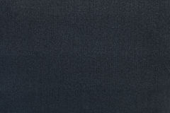 Dark blue background from a textile material. Fabric with natural texture. Backdrop. royalty free stock photos