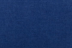 Dark blue background from textile material. Fabric with natural texture. Dark blue background from a textile material. Fabric with natural texture. Cloth royalty free stock image