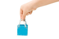 Dark blue bag in a female hand Stock Images