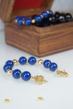 Dark blue Beaded Bracelet with gold clasp Royalty Free Stock Photos
