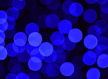 Dark blue and black bokeh background Stock Photos