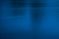 Dark blue and black conceptual abstract background. Deep and blurred, dark blue and black water surface, conceptual abstract background. Dark, sullen atmosphere Stock Images