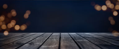 Dark blue bokeh background with wooden stage Stock Images
