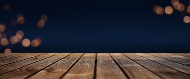 Dark blue bokeh background with wooden stage Royalty Free Stock Image