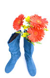 Dark blue boot and flowers Stock Photo